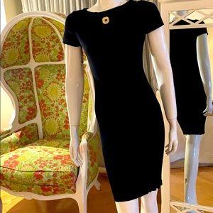 Authentic Chanel black classic Camellia dress.